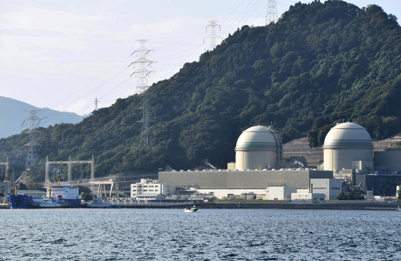 FILE - In this Sept. 21, 2017, file photo, the Pacific Egret cargo vessel, left, carrying MOX, a mixture of plutonium and uranium fuel, arrives at Takahama nuclear power plant in Takahama, western Japan. Japan and the U.S. extended their nuclear pact on Tuesday, July 17, 2018, as Tokyo pledged to work to reduce its plutonium stockpile to address Washington's concern. The 30-year pact agreed upon in 1988 has allowed Japan to extract plutonium and enrich uranium for peaceful uses even though the same technology can make atomic bombs. (Madoka Ogawa/Kyodo News via AP, File)