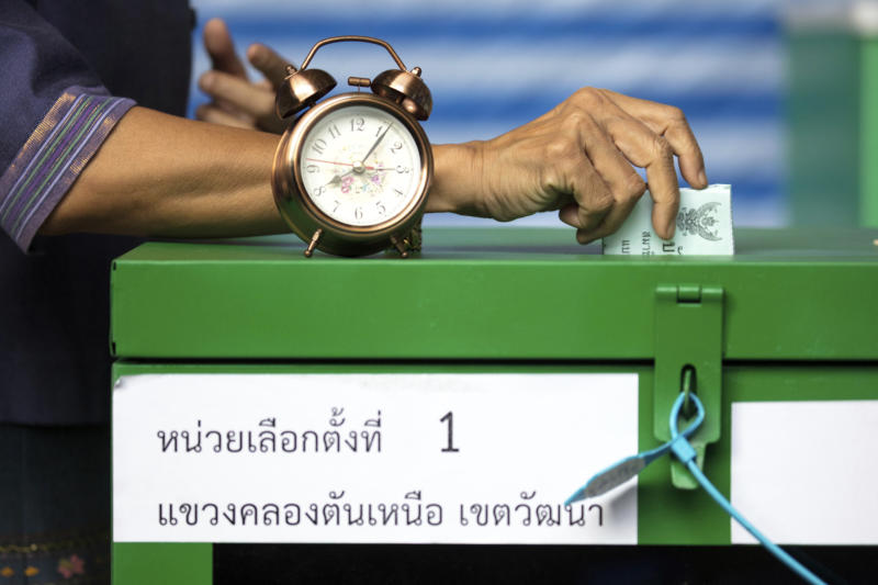 A woman casts her vote at a polling station in Bangkok, Thailand, Sunday, March 24, 2019, during Thailand's first general election since the military seized power in a 2014 coup. (AP Photo/Wason Wanichakorn)