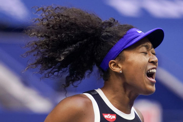 FILE - In this Sept. 12, 2020, file photo, Naomi Osaka, of Japan, reacts during the women's singles final against Victoria Azarenka, of Belarus, during the U.S. Open tennis tournament in New York. Osaka has been selected by The Associated Press as the Female Athlete of the Year. (AP Photo/Seth Wenig, File)
