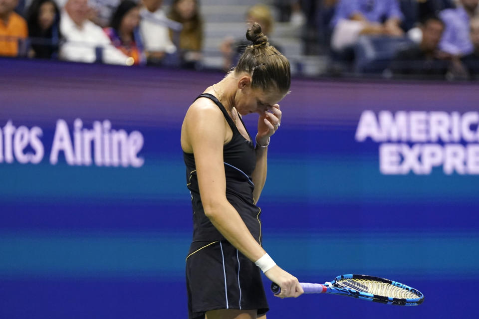 Karolina Pliskova, of the Czech Republic, reacts after missing a shot to Maria Sakkari, of Greece, during the quarterfinals of the U.S. Open tennis tournament Wednesday, Sept. 8, 2021, in New York. (AP Photo/Frank Franklin II)
