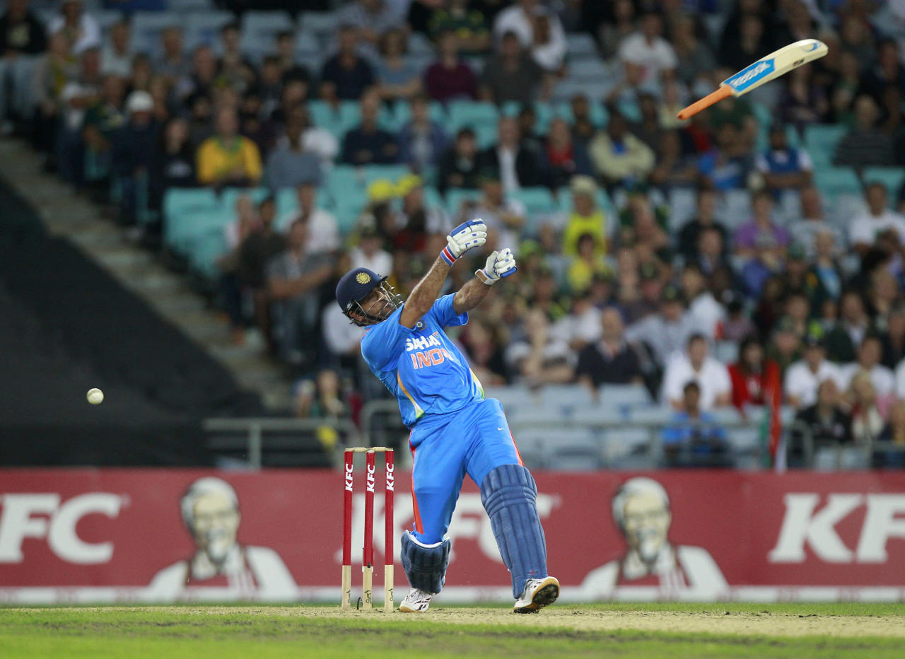 India's MS Dhoni loses control of his bat during a T20 cricket match against Australia in Sydney February 1, 2012. REUTERS/Daniel Munoz   (AUSTRALIA - Tags: SPORT CRICKET TPX IMAGES OF THE DAY)