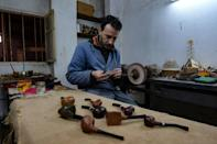 Anis Bouchnak and some of the wood pipes he has carved; the Bouchnak family workshop was established half a century ago