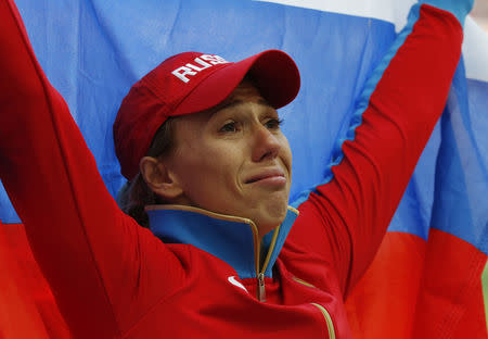 Maria Abakumova of Russia celebrates with her national flag after finishing third in the women's javelin throw final during the IAAF World Athletics Championships at the Luzhniki stadium in Moscow August 18, 2013. REUTERS/Grigory Dukor