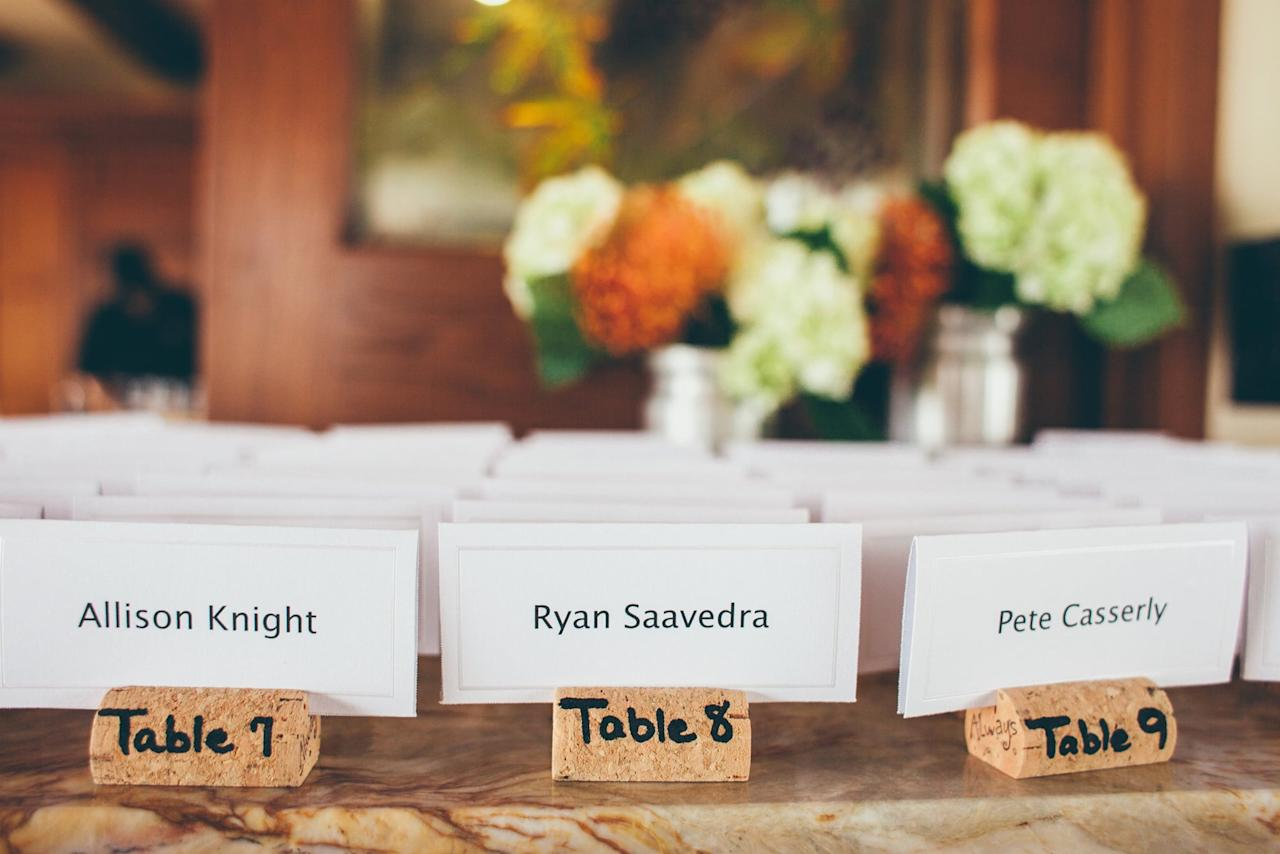 """<p>Use one, two, or three corks to make unique place-card holders for special events like a dinner party or a <a class=""""sugar-inline-link ga-track"""" title=""""Latest photos and news for wedding"""" href=""""https://www.popsugar.com/Wedding"""" target=""""_blank"""" data-ga-category=""""Related"""" data-ga-label=""""https://www.popsugar.com/Wedding"""" data-ga-action=""""&lt;-related-&gt; Links"""">wedding</a>. Cut a slit in the cork if you're only using one. Tie it up with a ribbon or stick a trinket on it to jazz it up.  </p>"""