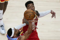 Brooklyn Nets guard Bruce Brown (1) is fouled by Atlanta Hawks forward John Collins (20) during the first half of an NBA basketball game Wednesday, Jan. 27, 2021, in Atlanta. (AP Photo/Brynn Anderson)