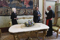 U.S. Secretary of State Mike Pompeo and U.S. Ambassador to the Holy See Callista L. Gingrich, left, meet Vatican Secretary of State Cardinal Pietro Parolin, at the Vatican, Thursday, Oct. 1, 2020. Pompeo is meeting Thursday with top Vatican officials, a day after tensions over U.S. opposition to the Vatican's China policy spilled out in public. (Vatican Media via AP)
