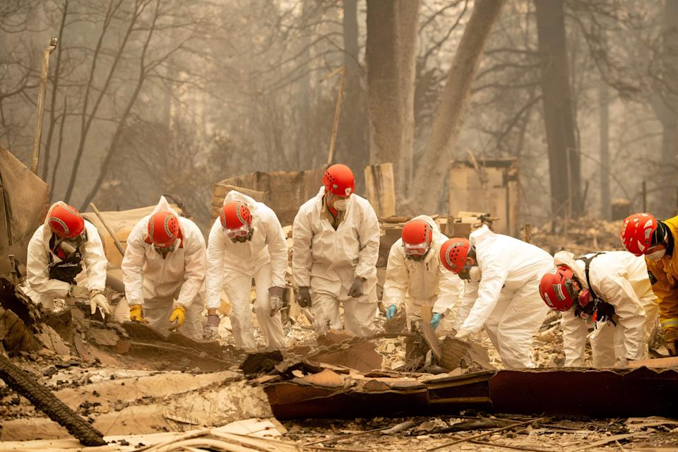 Rescue workers sift through the remains of a building in Paradise, California (AFP/Getty)