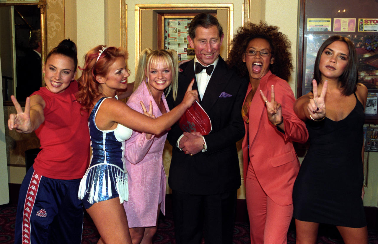 <p>In a now-famous photocall with Prince Charles (who resembles every fan girl in this very image) – the pop group stuck to their sartorial guns. Sporty Spice wore protocol-breaking Kappa trackpants while Baby Spice donned failsafe pink (and her go-to bunches) for the regal meeting. <em>[Photo: Getty]</em> </p>