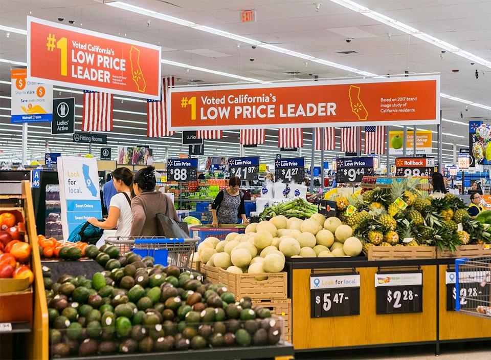 walmart produce section with clearance signs