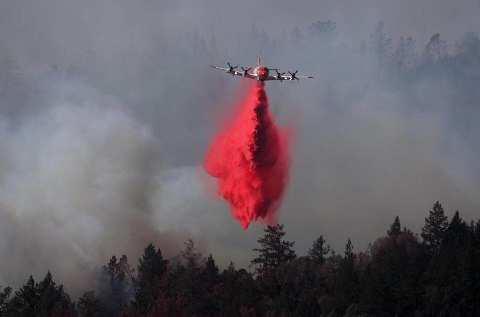 A plane drops fire retardant on the Glass Fire last September (Getty)