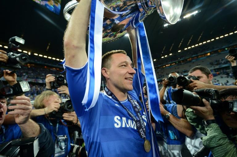 Chelsea's defender John Terry holds the trophy after the UEFA Champions League final in 2012