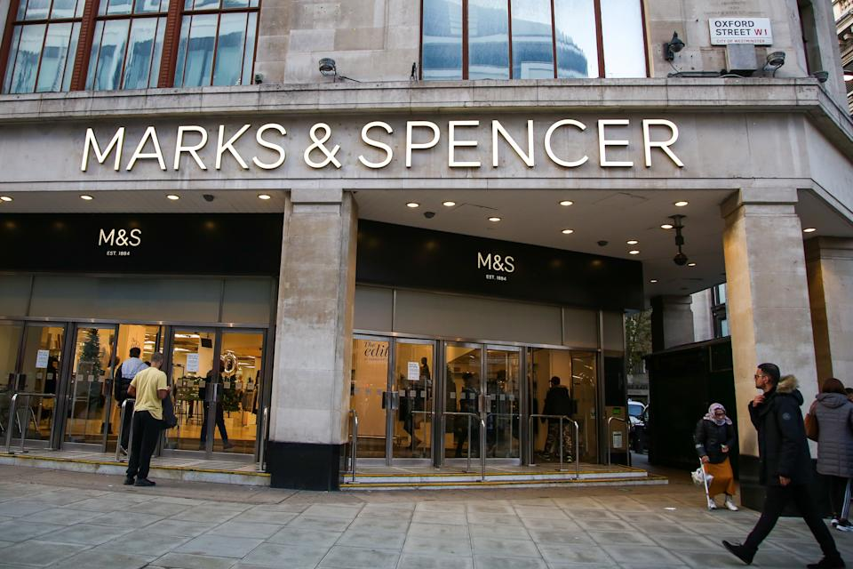 LONDON, UNITED KINGDOM - 2020/11/07: People walk past a branch of Marks and Spencer on Oxford Street in central London. (Photo by Dinendra Haria/SOPA Images/LightRocket via Getty Images)