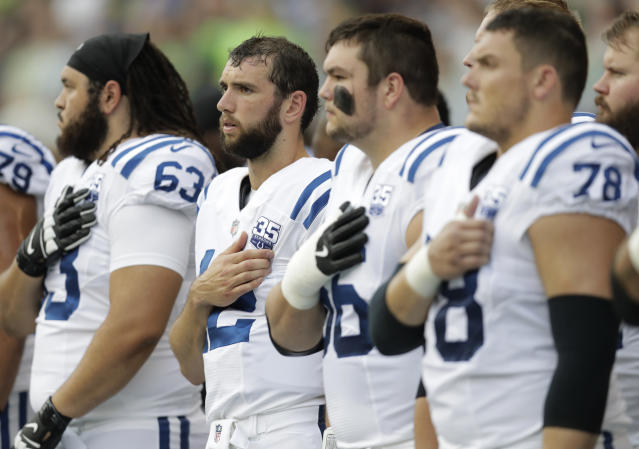 Indianapolis Colts players, including quarterback Andrew Luck, second from left, stand during the singing of the national anthem before an NFL football preseason game against the Seattle Seahawks, Thursday, Aug. 9, 2018, in Seattle. (AP Photo/Stephen Brashear)