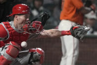 Philadelphia Phillies catcher Andrew Knapp is hit on the face mask by a pitch during the sixth inning of the team's baseball game against the San Francisco Giants on Friday, June 18, 2021, in San Francisco. (AP Photo/Tony Avelar)