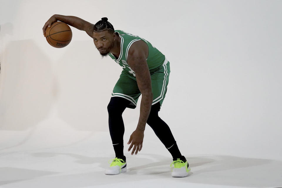 Boston Celtics guard Marcus Smart dribbles the ball for a photo shoot during the Boston Celtics Media Day, Monday, Sept. 27, 2021, in Canton, Mass. (AP Photo/Mary Schwalm)