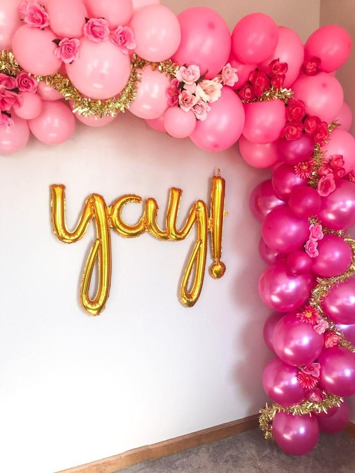 """<p>Balloon arches are a party essential, and putting one together is probably a lot easier than you think. </p><p><strong><em><a href=""""https://prettycolorfullife.com/index.php/2020/02/18/how-to-make-a-ombre-pink-balloon-arch-with-flowers/"""" rel=""""nofollow noopener"""" target=""""_blank"""" data-ylk=""""slk:Get the tutorial at Pretty Colorful Life"""" class=""""link rapid-noclick-resp"""">Get the tutorial at Pretty Colorful Life</a>. </em></strong></p><p><a class=""""link rapid-noclick-resp"""" href=""""https://www.amazon.com/Tatuo-Balloon-Garland-Decorating-Stickers/dp/B082VPRZ6Q?tag=syn-yahoo-20&ascsubtag=%5Bartid%7C10070.g.37055923%5Bsrc%7Cyahoo-us"""" rel=""""nofollow noopener"""" target=""""_blank"""" data-ylk=""""slk:SHOP BALLOON GLUE DOTS"""">SHOP BALLOON GLUE DOTS</a></p>"""