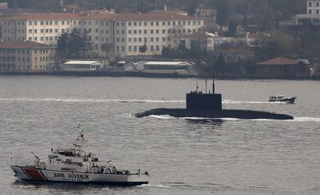 Russia's diesel-electric submarine Rostov-on-Don is escorted by a Turkish Navy Coast Guard boat as it sets sail in the Bosphorus, on its way to the Black Sea, in Istanbul, Turkey