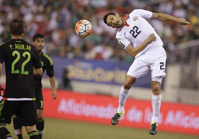 Costa Rica's Jose Miguel Cubero (22) heads the ball in front of Mexico's Paul Aguilar (22) during the second half of a CONCACAF Gold Cup soccer match Sunday, July 19, 2015, at MetLife stadium in East Rutherford, N.J. (AP Photo/Mel Evans)