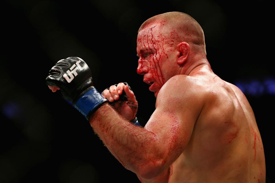 NEW YORK, NY - NOVEMBER 04: Georges St-Pierre of Canada fights Michael Bisping of England in their UFC middleweight championship bout during the UFC 217 event at Madison Square Garden on November 4, 2017 in New York City.  (Photo by Mike Stobe/Getty Images)