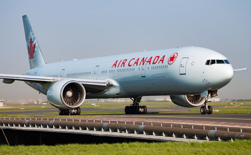 Paris / France - April 24, 2015: Air Canada Boeing 777-300ER C-FIVS passenger plane arrival and landing at Paris Charles de Gaulle Airport
