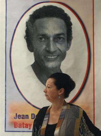 Montas, a former spokeswoman for U.N. Secretary-General Ban is seen in front of a picture of her late husband Jean Dominique at her house in Port-au-Prince