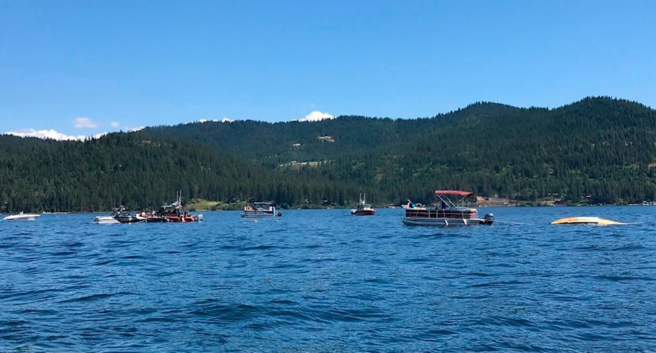 A crashed seaplane (far right) in the water at Lake Coeur d'Alene on July 5 after two planes collided in Idaho.
