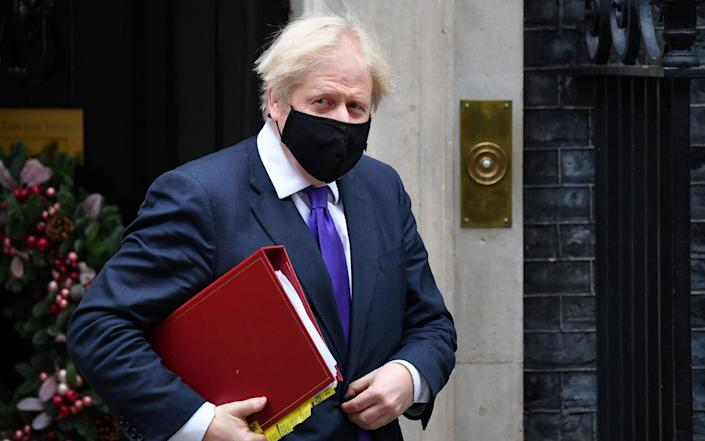 Britain's Prime Minister Boris Johnson wearing a face mask because of the coronavirus pandemic leaves number 10 Downing Street in central London on December 2, 2020, - Justin Tallis/AFP