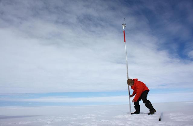 <p>David Vaughan, a glaciologist with the British Antarctic Survey, installs a pole as part of a satellite monitoring system into the Wilkins Ice Shelf off the Antarctic Peninsula on Jan. 18, 2009. The huge Antarctic ice shelf is on the brink of collapse with just a sliver of ice holding it in place, the latest victim of global warming that is altering maps of the frozen continent. (Photo: Alister Doyle/Reuters) </p>