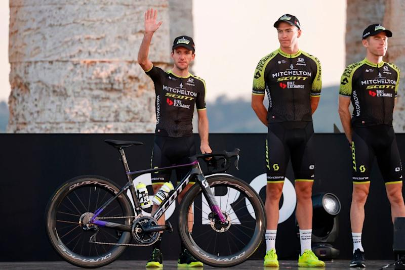 Team Mitchelton rider Great Britains Simon Yates L waves on stage at the Doric Temple of Segesta near Palermo Sicily on October 1 2020 during an opening ceremony of presentation of participating teams and riders two days ahead of the departure of the Giro dItalia 2020 cycling race Photo by Luca Bettini AFP Photo by LUCA BETTINIAFP via Getty Images