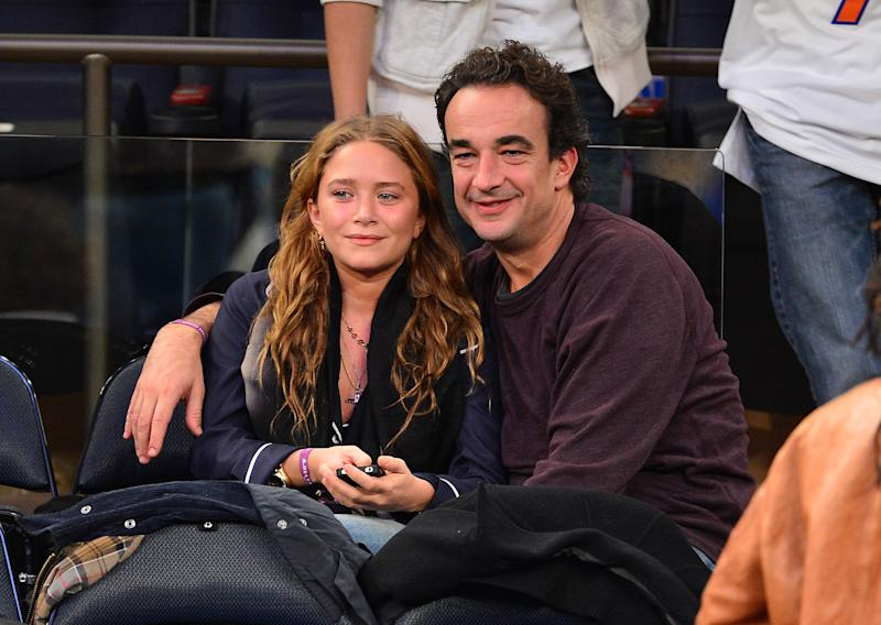 Mary-Kate Olsen and Olivier Sarkozy were together for 8 years. Here they are at a New York Knicks game at Madison Square Garden in November 2012.
