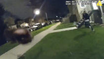 In this image taken from Chicago Police body cam video from early Wednesday, March 31, 2021, Anthony Alvarez, right, runs away during a police foot chase in Chicago. Alvarez was fatally shot by police during the incident. Police claim Alvarez, 22, brandished a gun while being chased. (Civilian Office of Police Accountability via AP)