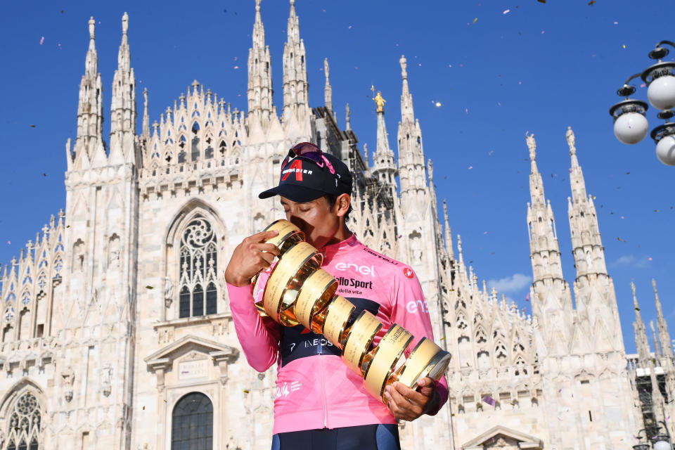 Colombia's Egan Bernal celebrates on podium after completing the final stage to win the Giro d'Italia cycling race, in Milan, Italy, Sunday, May 30, 2021. (Gian Mattia D'Alberto/LaPresse via AP)