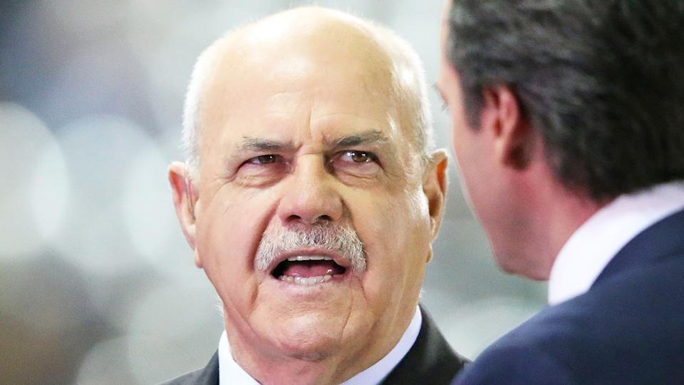 Leigh Matthews, pictured broadcasting for Channel 7, has criticised AFL players for not accepting a larger pay cut.