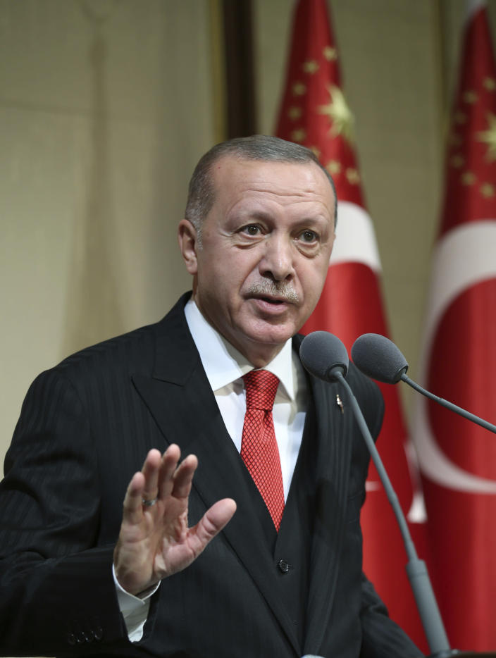 """Turkish President Recep Tayyip Erdogan speaks during a reception on Republic Day, in Ankara, Turkey, Tuesday, Oct. 29, 2019. Erdogan said Russia has informed Turkey that Syrian Kurdish fighters have """" completely been removed """" from the areas in northeast Syria.( Presidential Press Service via AP, Pool)"""