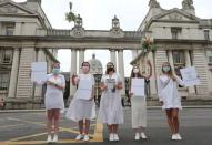 People march to Government Buildings in a bid to allow up to 100 guests to attend weddings this year in Dublin