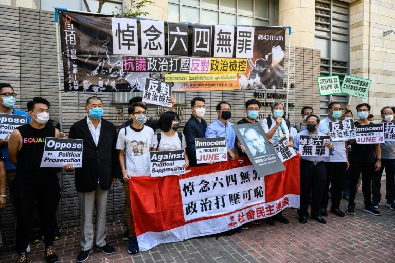 Hong Kongers including millionaire media tycoon Jimmy Lai (third from left) gather outside a court where activists are facing charges for holding an unauthorized commemoration of the 1989 crackdown in Tiananmen Square