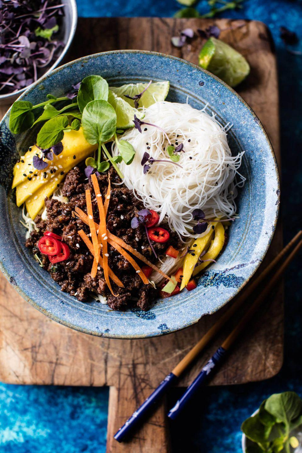 "<p>This quick-and-easy weeknight meal takes just 30 minutes but eats like a feast.</p><p><em><a href=""https://www.halfbakedharvest.com/30-minute-asian-basil-beef-mango-noodle-salad/"" rel=""nofollow noopener"" target=""_blank"" data-ylk=""slk:Get the recipe from Half Baked Harvest »"" class=""link rapid-noclick-resp"">Get the recipe from Half Baked Harvest »</a></em></p>"