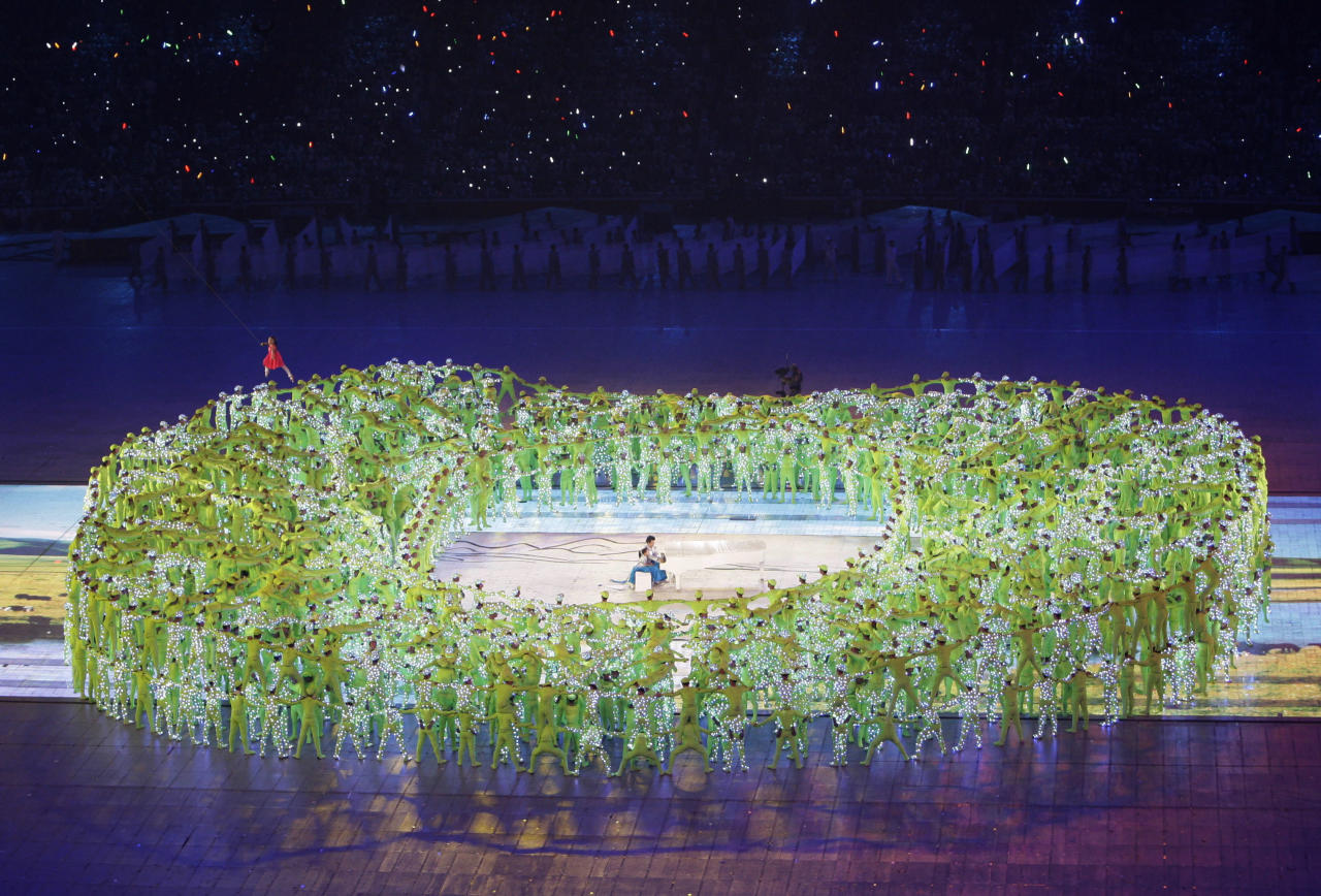 "Performers reassemble the national stadium, also known as ""Bird's Nest"" as they fill the floor of the National Stadium during the opening ceremonies for the Beijing 2008 Olympics in Beijing, Friday, Aug. 8, 2008. (AP Photo/David Guttenfelder)"