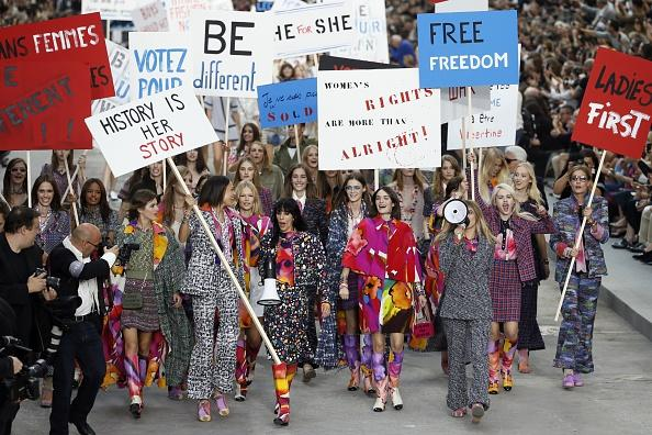 Cara Delevingne walks in Chanel's 2014 fashion show turned feminist rally.