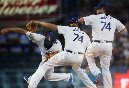 June 16, 2018; Los Angeles, CA, USA; (Editors note: multiple exposure image) Los Angeles Dodgers relief pitcher Kenley Jansen (74) throws in the ninth inning against the San Francisco Giants at Dodger Stadium. Mandatory Credit: Gary A. Vasquez-USA TODAY Sports