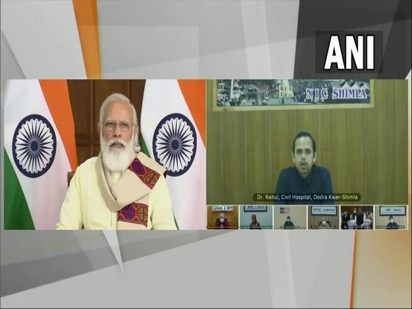 PM Narendra Modi interacts with healthcare workers & beneficiaries of COVID vaccination programme in Himachal Pradesh via video conferencing. (Photo/ ANI)