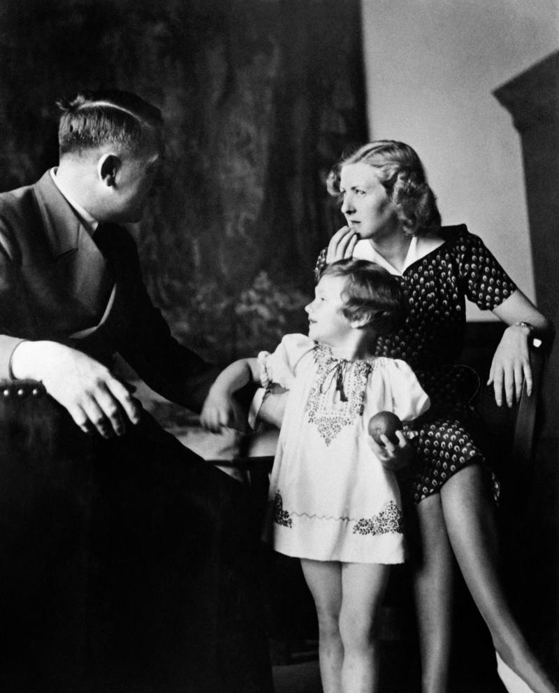 "Eva Braun poses with Ursula ""Uschi"" Schneider, daughter of her best friend Herta Schneider, and her companion Adolf Hitler, Führer of the German Reich,in the 40s, at the Berghof on the Obersalzberg, the house of Adolf Hitler, near Berchtesgaden, Bavaria, Germany. (Photo by - / AFP) (Photo credit should read -/AFP via Getty Images)"