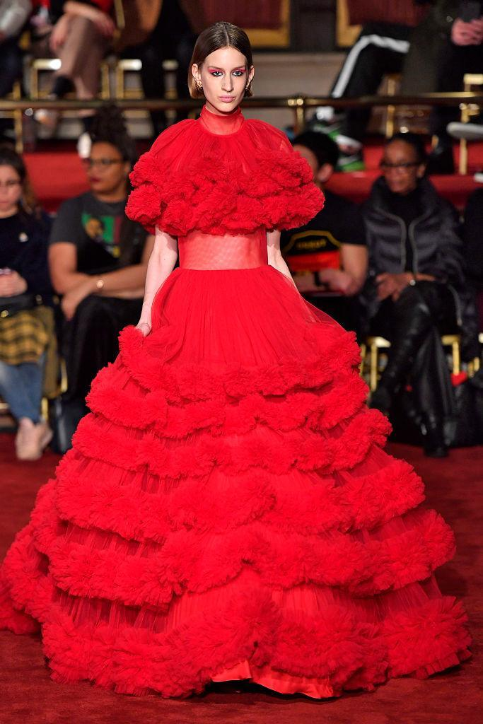 <p>A model wears a multitiered red gown at the Christian Siriano FW18 show. (Photo: Getty) </p>