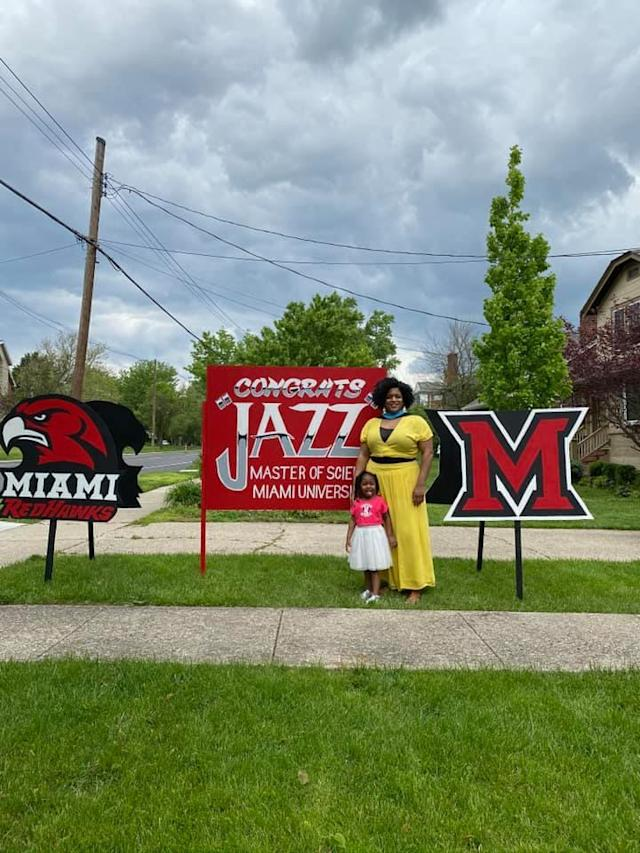 Recent Miami University graduate Jasmine Hardy has responded to her neighbours' demands to remove the sign in her front yard. Photo: Facebook/jasmineihardy.