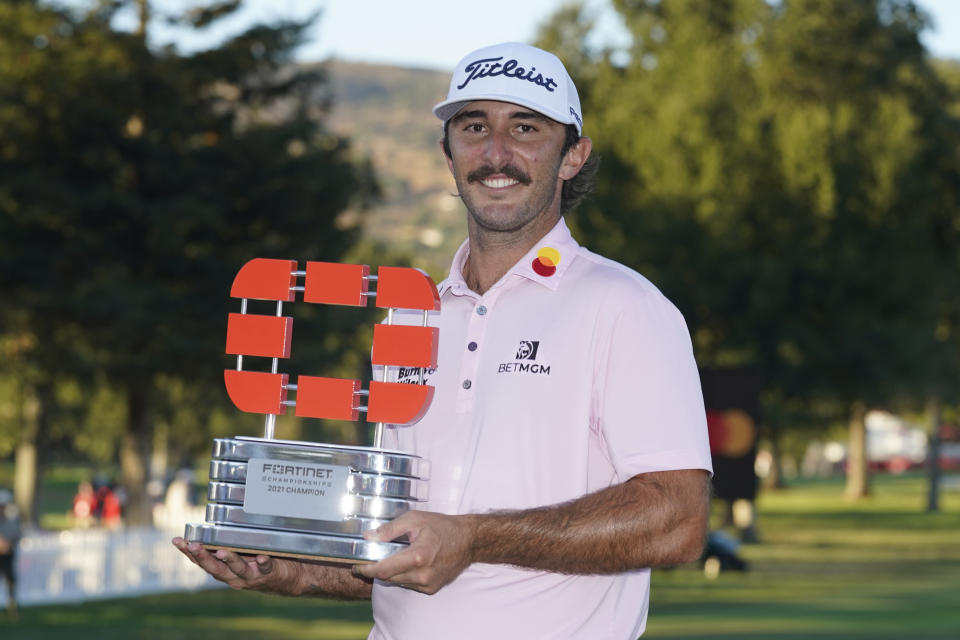 Max Homa poses with his trophy on the 18th green of the Silverado Resort North Course after winning the Fortinet Championship PGA golf tournament Sunday, Sept. 19, 2021, in Napa, Calif. (AP Photo/Eric Risberg)