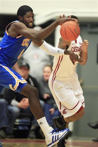 UCLA center Anthony Stover, left, beats Washington State guard DaVonte Lacy, right, to a loose ball during the first half of an NCAA college basketball game on Saturday, Feb. 4, 2012, in Pullman, Wash. (AP Photo/Dean Hare)