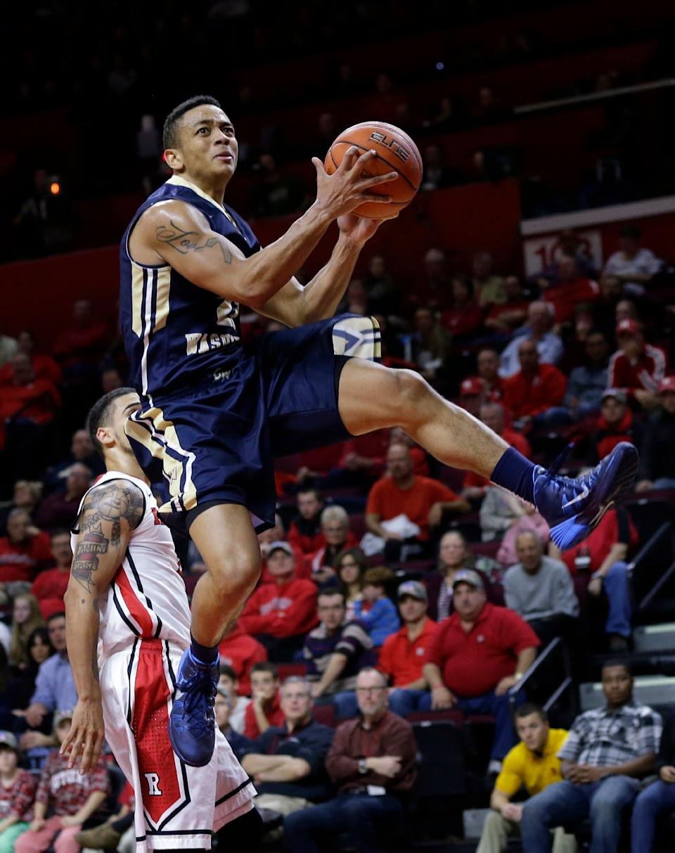 George Washington's Joe McDonald (22) goes up for a basket during the first half of an NCAA college basketball game against Rutgers Sunday, Nov.16, 2014, in Piscataway, N.J. (AP Photo/Mel Evans)