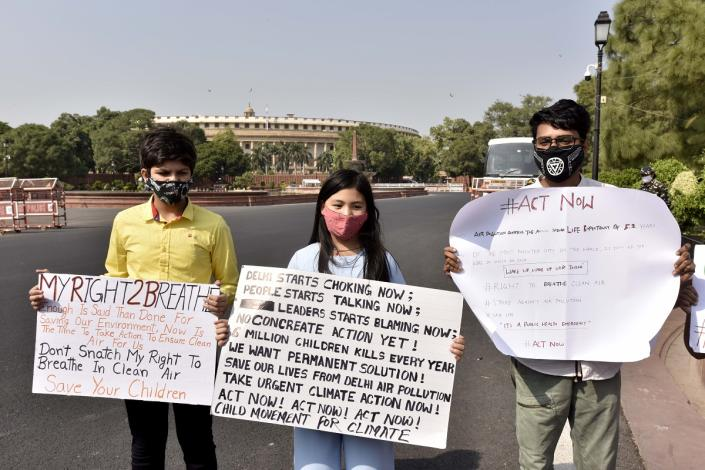 """NEW DELHI, OCTOBER 18: Licypriya Kangujam (C), a 9-year-old climate activist, stages a protest against air pollution in the national capital, at Vijay Chowk, on October 18, 2020 in New Delhi, India. The nine-year-old who has earlier addressed the United Nations Climate Conference 2019 (COP25) in Madrid, Spain, said, """"I want our leaders to take action to fight air pollution. They are busy blaming each other instead of finding a solution. No action is being taken."""" (Photo by Sanjeev Verma/Hindustan Times via Getty Images)"""