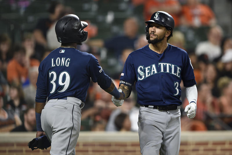 Seattle Mariners J.P. Crawford, right, is congratulated by Shed Long after hitting a three-run home run against the Baltimore Orioles during the eighth inning of a baseball game Saturday, Sept. 21, 2019, in Baltimore. The Mariners won 7-6 in 13 innings. (AP Photo/Gail Burton)