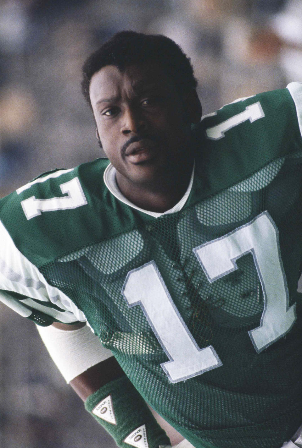 """FILE - In this Dec. 14, 1980, file photo, Philadelphia Eagles' Harold Carmichael stands during the team's NFL football game against the St. Louis Cardinals in Philadelphia. Next month, Carmichael will use those longs arms to put on his gold jacket in Canton. """"To be inducted, to get that gold jacket, and get that bust and get that ring is very exciting for me,"""" he said. (AP Photo/Clem Murray, File)"""